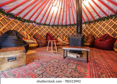 Traditional Yurt interior. Glamping with fire place for rest and company.