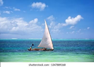 Traditional Zanzibar fishing boat in tropical ocean, Tanzania