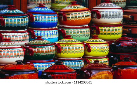 Traditionally decorated colorful souvenir pots in tourist shop, Bulgaria.