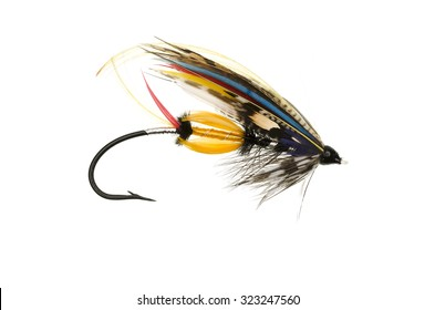 Traditionally dressed Jock Scott salmon fly shot against a white background