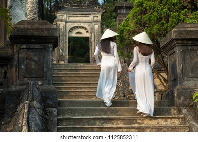 Traditionally dressed young vietnamese women in Royal Tumb of Khai Dinh King in Hue city,  Vietnam