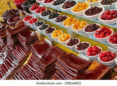 Traditionally dried and processed forest fruit strips and small bowls of sour plums, sour cherries and forest fruits to be sold in Darakeh and Darband recreational quarters of Tehran, Iran.