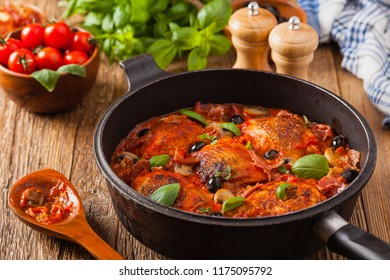 Traditionally made chicken in tomato sauce cacciatore. Front view.