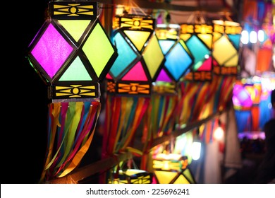 Traditionally made colorful lanterns fluttering in the winds on the Indian streetside decoration, on the occasion of Diwali festival in India