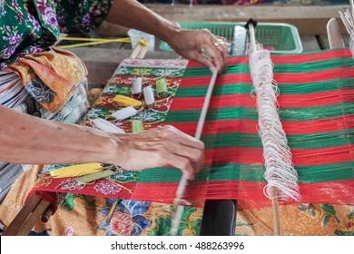 traditionally makes yarn with a spindle wheel at traditional Sasak village, Desa Sasak Sade, Lombok Indonesia.