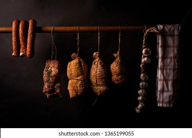 Traditionally smoked meats, ham, sausage, bacon in a smokehouse.