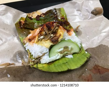 """Traditionally wrapped fragrant coconut rice or """"Nasi Lemak"""""""