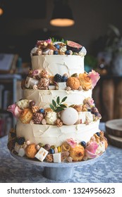 Traditionnal wedding cake decorated with fruits, biscuits, macroon and flowers