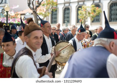 a traditonal madeira folklore music group s at the Festa da Flor or Spring Flower Festival in the city of Funchal on the Island of Madeira of Portugal.  Madeira, Funchal, April, 2018