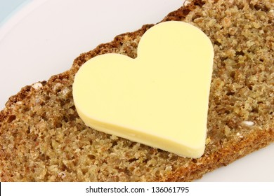 A traditonal slice of Irish wholewheat bread with heart shaped butter.