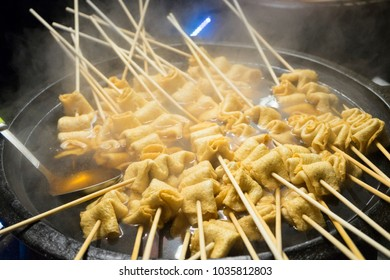 Tradtional Korean Street Food at Night Market in Myeongdong, South Korea. Variety of Fish Ball Skewers and Oden