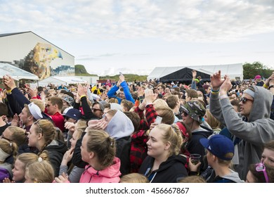 Traena, Norway - July 07 2016: audience of fan cheering at concert of Norwegian singer Astrid S at Traenafestival, music festival taking place on the small island of Traena