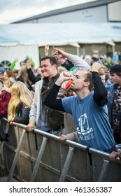 Traena, Norway - July 07 2016: audience cheering at concert of Norwegian punk rock band Viagra Boys at Traenafestival, music festival taking place on the small island of Traena