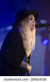 Traena, Norway - July 10 2014: during the concert of the Swedish folk rock band First Aid Kit at the Traenafestival, music festival taking place on the small island of Traena