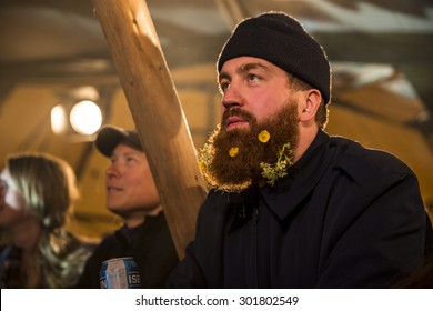 Traena, Norway - July 10 2015: man from the audience with flowers in his beard, concert of Norwegian band The Cameltoes at the Traenafestival, music festival taking place on the small island of Traena