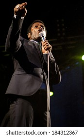 """Traena, Norway - July 11 2013: during the concert of the American blues rock band """"Vintage Trouble"""" at the Traenafestival, music festival taking place on the small island of Traena in Norway."""