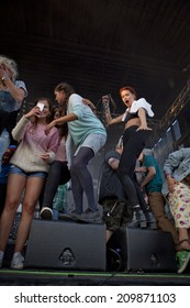 Traena, Norway - July 11 2014: during the concert of the Norwegian band Ida Maria  at the Traenafestival, music festival taking place on the small island of Traena