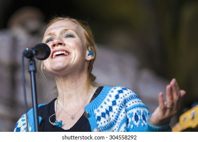 Traena, Norway - July 11 2015: concert of Norwegian singer Anneli Drecker at cathedral cave Kirkehelleren on Sanna Island, at Traenafestival, music festival taking place on the small island of Traena.