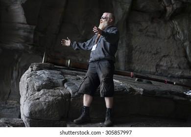 Traena, Norway - July 11 2015: performance of Norwegian artist Sysselmann before concert of Anneli Drecker at cathedral cave Kirkehelleren on Sanna Island, Traena music festival