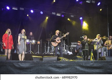 Traena, Norway - July 6 2017: concert of Norwegian reggae ska band QueDuhSka at Traenafestival, music festival taking place on the small island of Traena