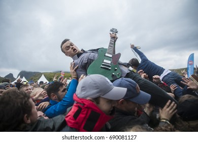 Traena, Norway - July 6 2017: singer and guitarist of Norwegian punk rock band Honningbarna crowd surfing at Traenafestival, music festival taking place on the small island of Traena