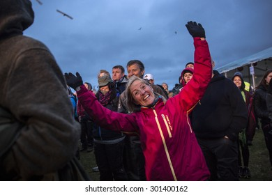 Traena, Norway - July 9 2015: fans cheering with arms up at concert of Norwegian rock band OnklP & De Fjerne Slektningene at Traenafestival, music festival taking place on the small island of Traena