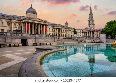 The Trafalgar square in London, England, with National Gallery and St Marting on the Fields church in dramatic light
