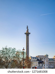 Trafalgar Square, London, England - November 18, 2018: Trafalgar Square, with view of nelson column in early morning time and with tourists around and other buildings.