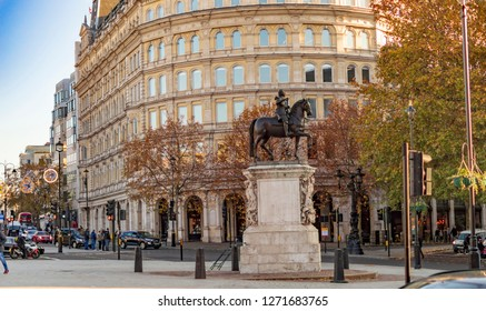 Trafalgar Square, London, England - November 18, 2018: Trafalgar Square, south side, with view of statue of Charles I on horseback and street along with modern buildings