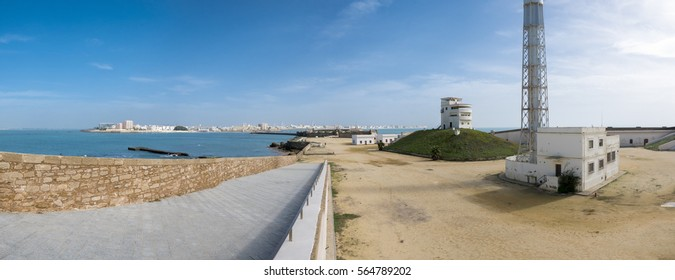 Trafalgar's lighthouse at the province of Cadiz with clear blue sky in the background.