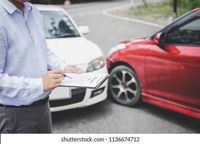 Traffic Accident and insurance concept, Insurance agent working on report form with car accident claim process.