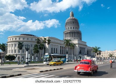 Traffic in avenue in front of the Capitol of Havana, one of the most visited areas in the city by tourists. Havana Cuba. January 2, 2019