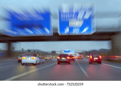 Traffic and big road signs on high speed motorway