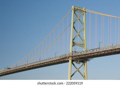 Traffic bridge on sunny day with blue sky.