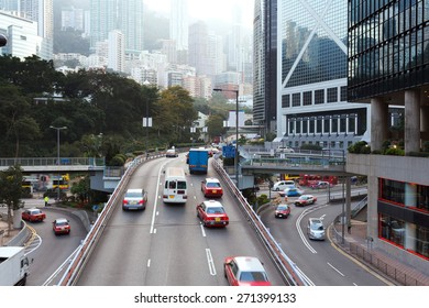 traffic and buildings at modern city hong kong during daytime.