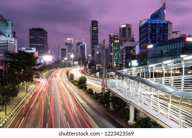 Traffic captured with blurred motion rush in Jakarta business district in Indonesia capital city at night
