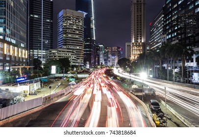 Traffic captured with long exposure rushing along Jl Sudirman, the main avenue in Jakarta business district, at night in Indonesia capital city.