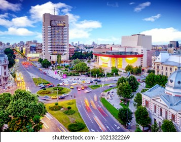 Traffic in the center of the capital city of Romania, Bucharest with blue sky and clouds.