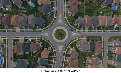 traffic circle in a suburban neighborhood from above with a drone