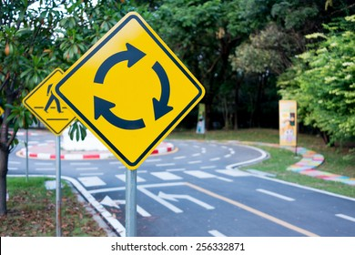 Traffic circle yellow sign