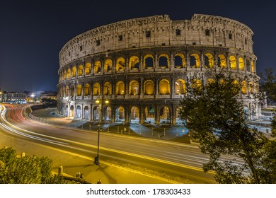 Traffic in a clear night in front of the Colosseum in Rome, Italy