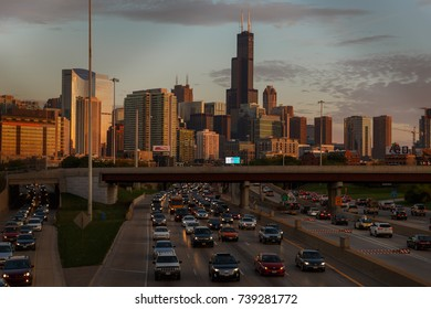 Traffic clogs the Kennedy Expressway, Interstate 90/94, at sunset before a backdrop of the skyline and the Willis Tower in Chicago, October 21, 2017.