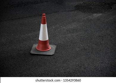 Traffic cone over asphalt