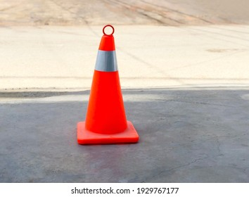 Traffic cones with white and orange stripes on outdoor background