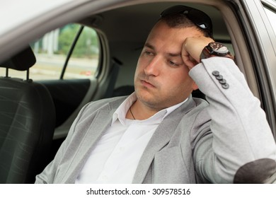Traffic congestion and a business man in the car