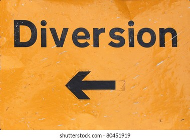 A traffic or a construction site sign - Diversion warning arrow street road transport signal