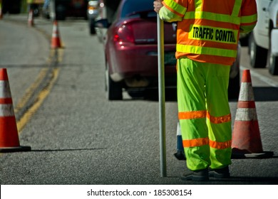 Traffic control is hazardous work, which is why they wear high visibility clothing.