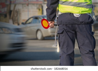 Traffic cop checking the traffic.