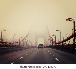 Traffic crossing a foggy Golden Gate Bridge in San Francisco