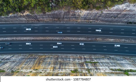 Traffic driving on a highway between two cliffs, Sydney, Australia